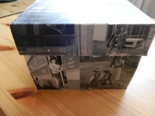 Storage box decorated with black and white pictures