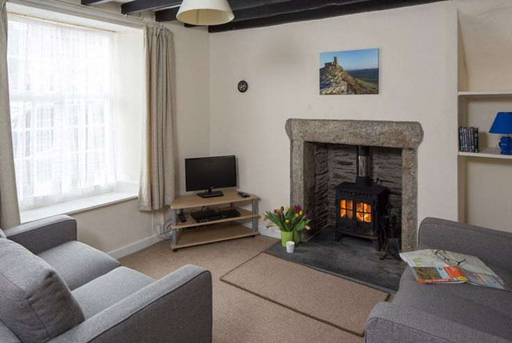 New! Ideally located for exploring the wilds of the moors on the edge of Tavistock, a lovely moorland market town with an eclectic mix of shops, pubs and restaurants and also an interesting daily pannier market, Holly Cottage is a cosy little Grade II Listed terraced property. #Holiday #Cottage #Devon #Dartmoor #Tavistock #Moorland #Cosy