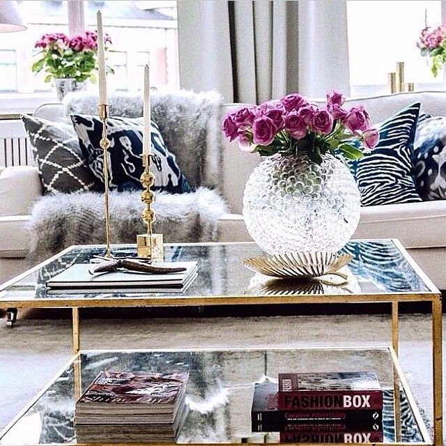 Key pieces for a chic coffee table flower glasses and fur