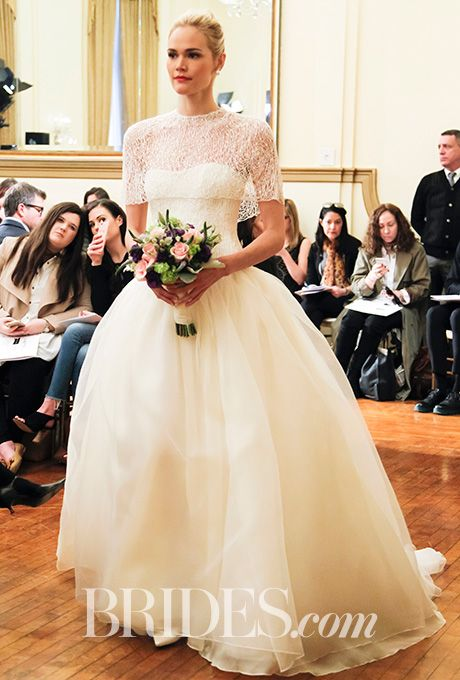 """Brides.com: . """"Corinne"""" ball gown in silk organza with bodice and cape of lace by Peter Langner"""