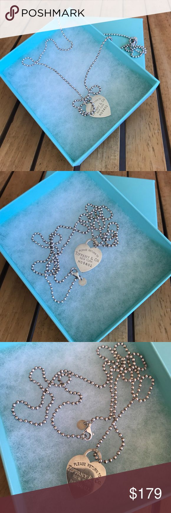 Tiffany heart necklace Pre-owned 100 % Authentic tiffany heart necklace. In very used good condition. Has sign of usage. Has mild scartches. Has 34 inches long. Comes with box no pouch. Please check all the pictures before purchasing. Tiffany & Co. Jewelry Necklaces
