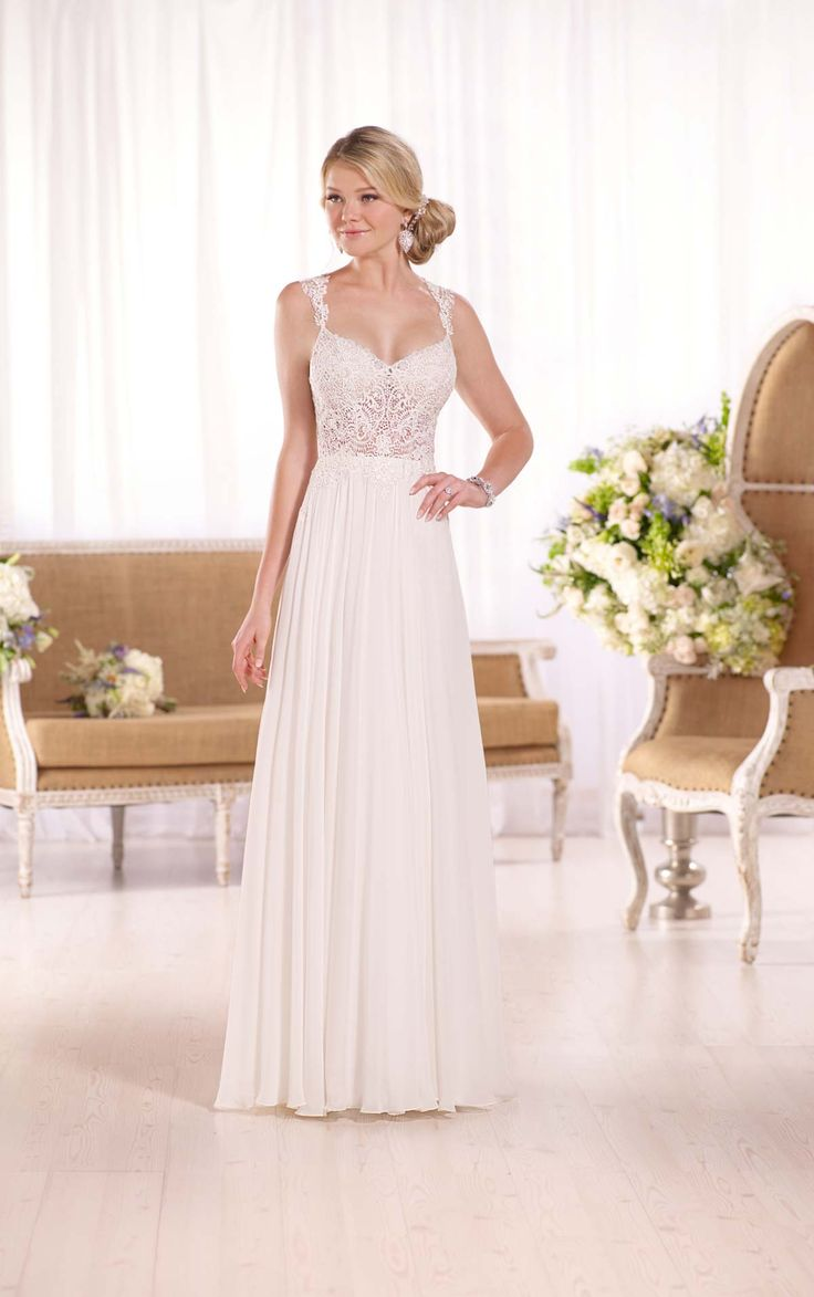 Essense of Australia's Guipure-Lace Illusion Wedding Dress is simple and stunning with the chiffon skirt featuring a slit. Essense of Australia