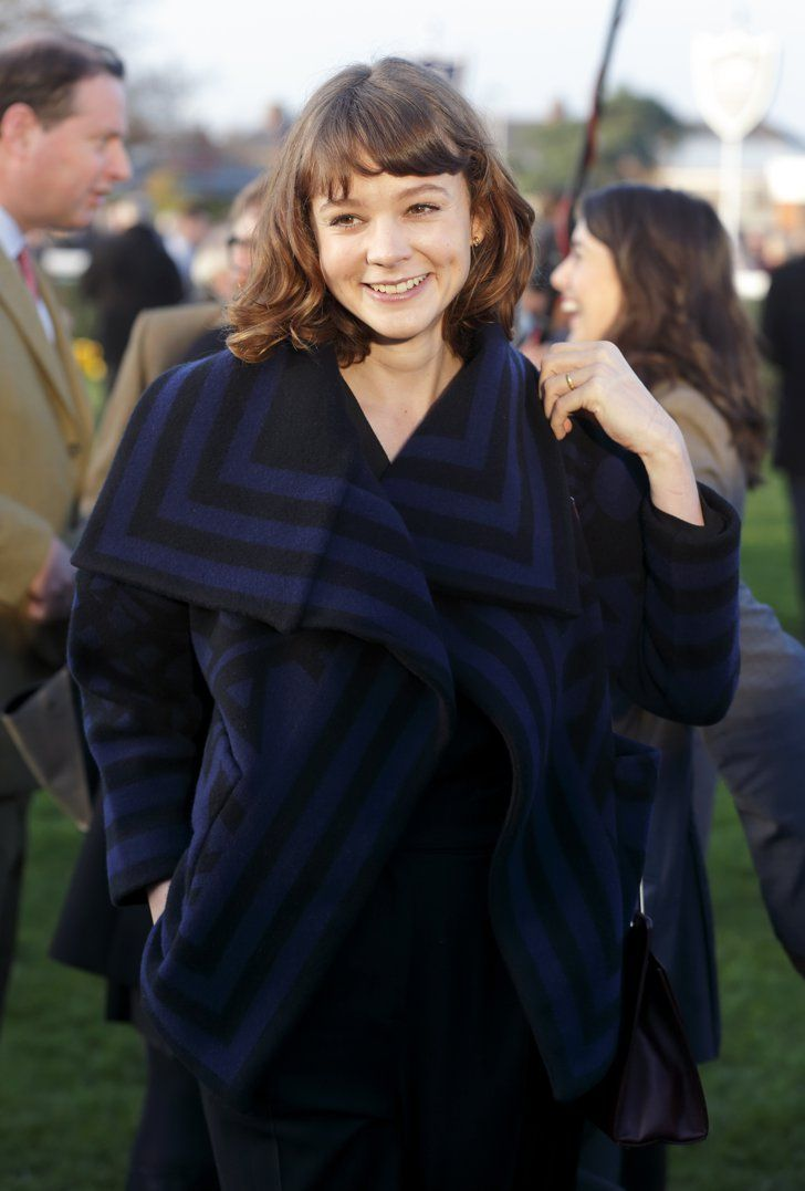 Pin for Later: The Weekend's Must-See Snaps!  On Saturday, Carey Mulligan lit up with a smile during the Hennessy Gold Cup at Newbury Racecourse in Newbury, England.