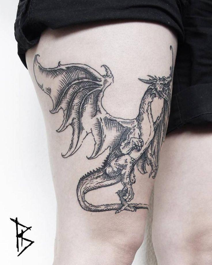 Engraving style dragon tattoo on the right thigh. Tattoo Artist: Loïc LeBeuf