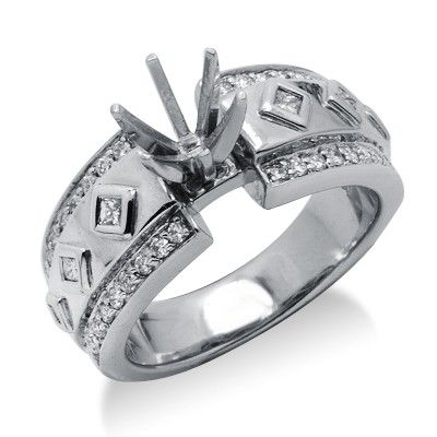 Enhance your personal style with this attractive ring! Handcrafted in lustrous 14k white gold, this beautiful diamond semi mount ring features a lovely design with shimmering round cut diamonds surrounding the princess cut diamonds held in a secure bezel setting showcasing the setting in the center. Mount fits 6.4 mm, round cut stone. The color of the diamonds are G/H and the clarity is SI2/SI3.Different head sizes may be available to fit different sized and shaped stones.Different ring…