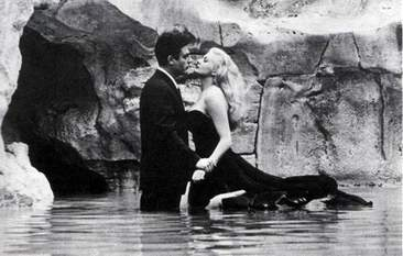 "Fellini's ""La Dolce Vita"", a non-linear journey of Marcello, an apathetic journalist, through seven episodes in 1960's Rome. Stylistically and cinematically brilliant, however, not for those that are looking for a concrete plot or character development. Very introspective, and walks on the border of neo-realism and art. Stars Marcello Mastroianni, Anita Ekberg, Anouk Aimee, and Alain Cuny. Italian."