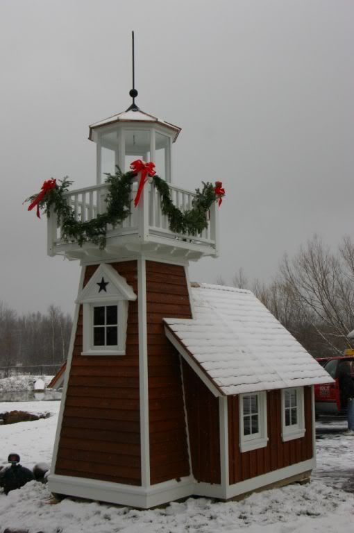 *Lighthouse Shed -The design resembles the lighthouse located on Grand lsland in Lake Superior.  (Built for Hospice Charity Auction - It went for $9500.)