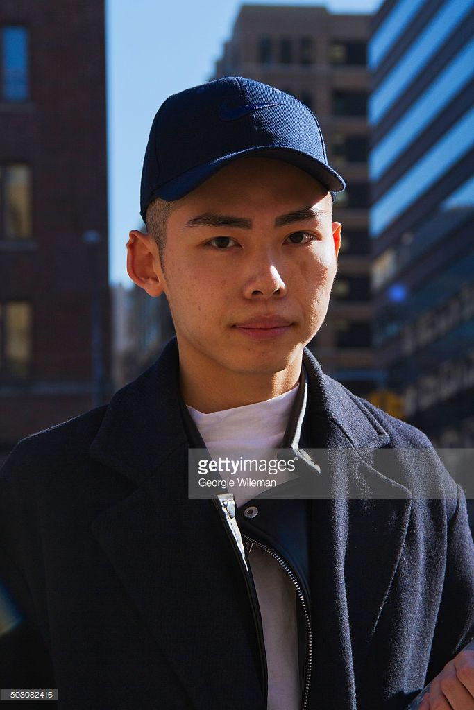 Alan Tam seen at Skylight Clarkson Sq outside the Duckie Brown show wearing APC blue jacket, white Zara top, Nike cap and Topman coat during New York Fashion Week: Men's Fall/Winter 2016 on February 2, 2016 in New York City.