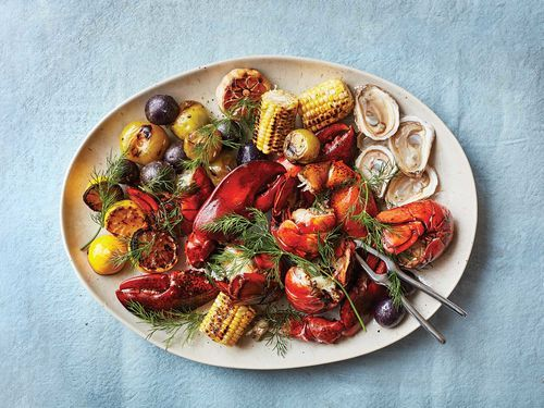 Coal-Grilled Lobsters with Charred Corn, Tomatillos, and Blue Potatoes