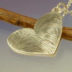 Double Fingerprint Heart Pendant. To make with Salt Dough and spray paint it.