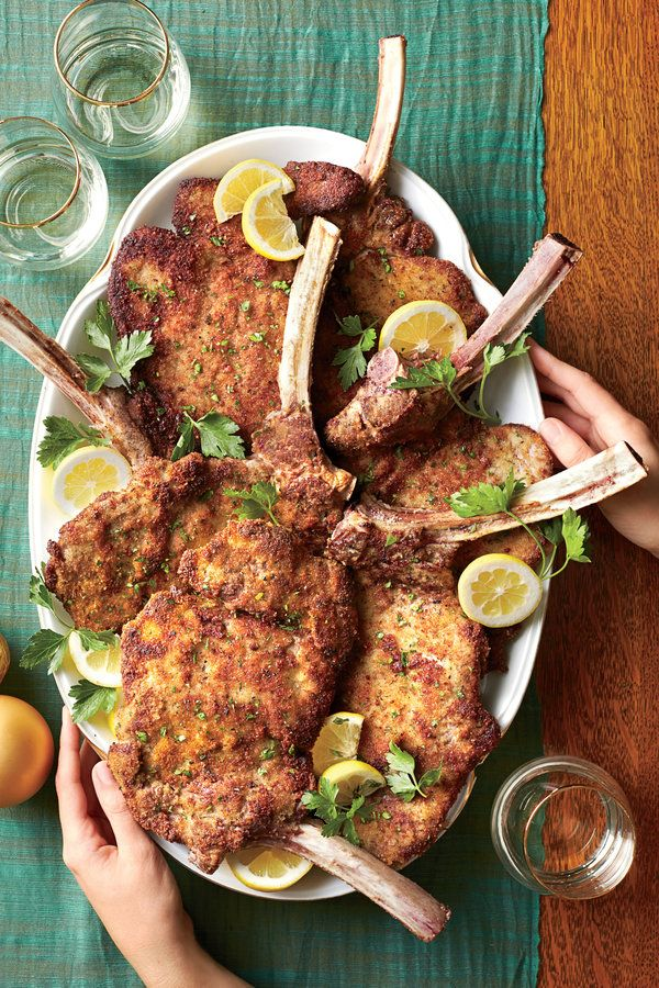 "Ask your butcher to ""french"" the chops for you so you take home clean meat that's ready to prep.     Recipe: Veal Chops Milanese with Lemon and Herbs"