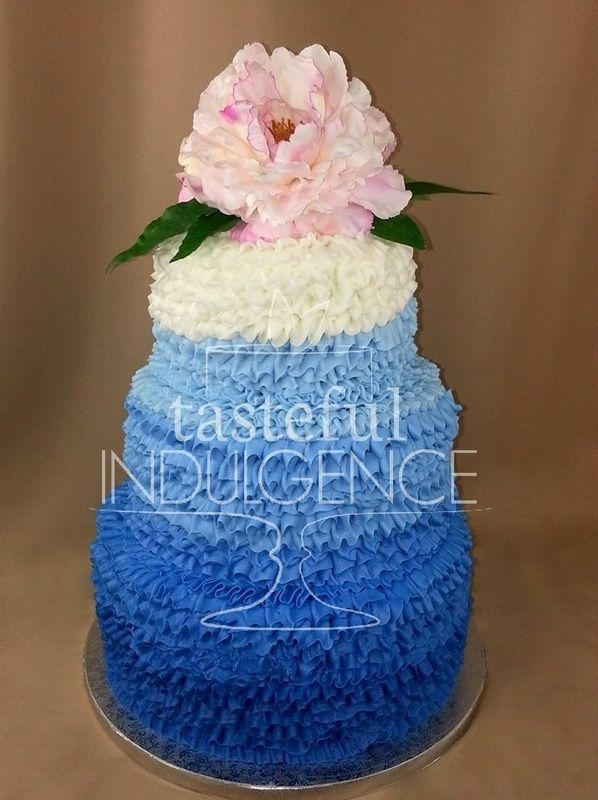 4 tier royal blue ombre ruffle wedding cake, accented with large pink peony. #caketodiefor Seward, Nebraska