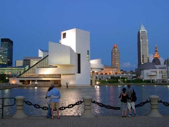 This is downtown Cleveland, Ohio. Specifically, this is the Rock and Roll Hall of Fame and Museum. Cleveland holds the Rock and Roll Induction Ceremonies every 3rd year (New York has it the other two years), with Cleveland holding it again in 2012 (April 5-14). You can also see the Terminal Tower and the Key Bank Tower (both on the right, with the smaller being the Terminal Tower).