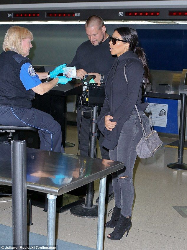 Helping hand: Kim's trusty bodyguard handled the tedious paperwork on this trip