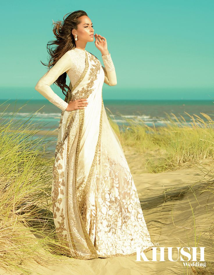 Sabyasachi Mukherjee shimmers in the sunlight in this timeless ivory lace sari available at Aashni & Co. Official 47 Ledbury Road, London W11 2AA +44 (0)207 985 0155 info@aashniandco.com aashniandco.com Hair and Makeup: Henna-h Beauty Jewellery: Amrapali Jewels