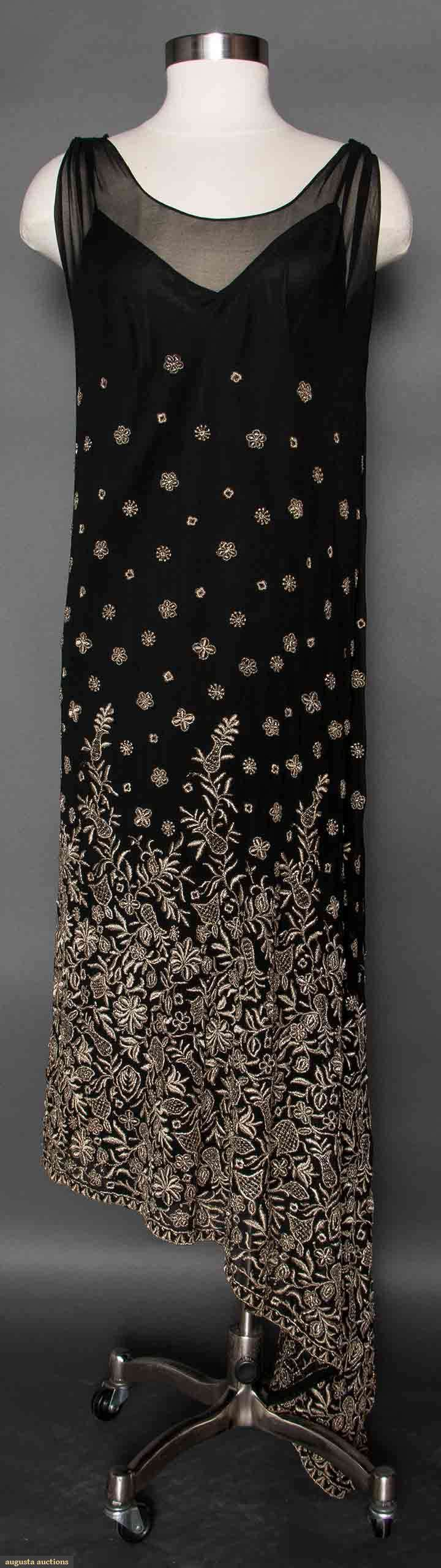 EMBROIDERED BLACK SILK DRESS, 1920s Silk chiffon, sleeveless, angled hemline, bottom skirt half densely embroidered in metallic silver floral pattern