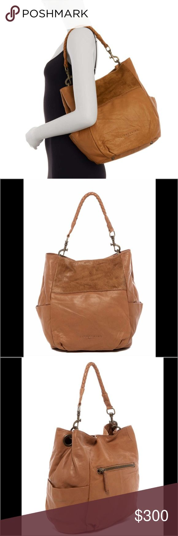 "Liebeskind Berlin Leather Shoulder Bag Liebeskind Berlin Leather with Genuine Calf Hair Bag.  NWT.  Detachable woven top handle with detachable, adjustable shoulder strap - Zip top closure - Exterior features back zip wall pocket and dual side slip pockets - Interior features zip wall pocket, slip wall pocket and 2 media pockets - Approx. 12"" H x 13.75"" W x 5.75"" D - Approx. 7"" handle drop, 19-23"" strap drop  Materials Light cognac (leather and genuine calf hair) Liebeskind Bags Shoulder…"