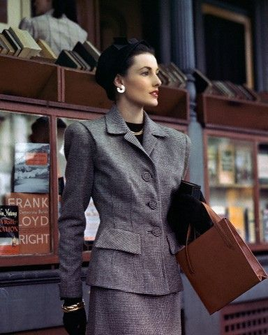 """Model is wearing a brown and beige wool tweed suit, carrying a brown leather handbag, August 1945."" #vintage #fashion #suit #1940s"