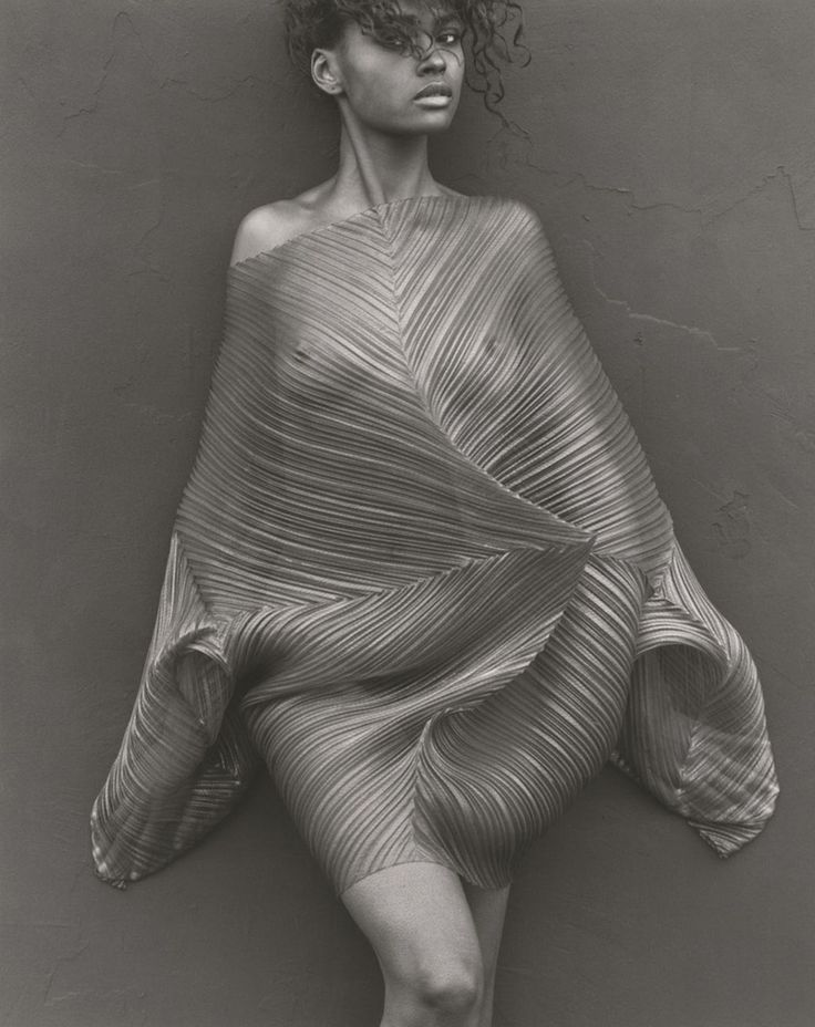 Karen Thinly veiled, 1989 by Herb Ritts || Issey Miyake dress