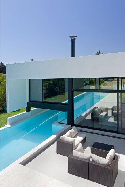 An indoor/outdoor pool by R E M Y | arquitectos