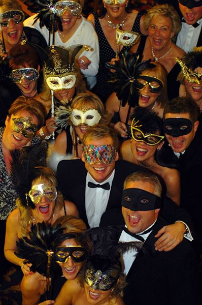 guests in party wear and masks