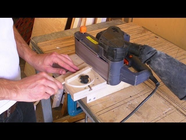 Portable belt sanders are common among avid DIYers, as they have a multitude of uses around the shop and your home. But the typical standalone edge sanders, like this one from Jet, can run North of $1,000. With a little work, though, you can transform your hand-held belt sander into a usable edge sander.