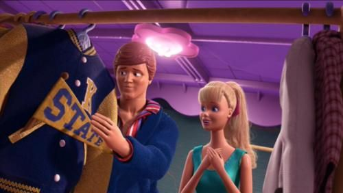 """When Barbie is going through Ken's closet, they come across a blue and gold letterman jacket with a """"K"""" embroidered on the breast and a """"State"""" pennant laying across the front.Michael Keaton, the voice of Ken, graduated from Kent State University, whose colors are blue and gold."""