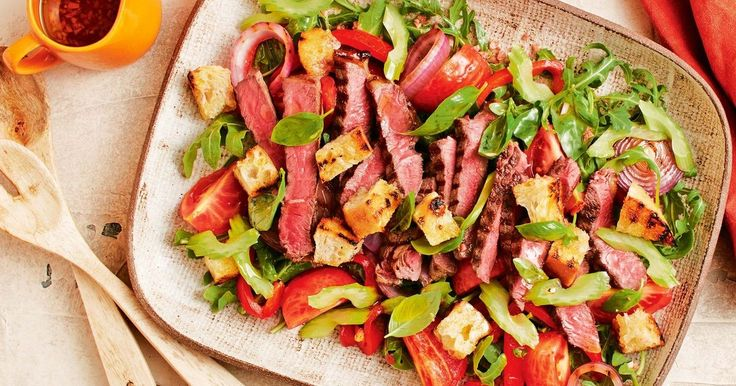 """A salad extravaganza! Let the veggies macerate in vinaigrette while you char your ciabatta and cut it into croutons. Then layer it all up on rocket leaves and top with juicy barbecued rump steak."" - Curtis Stone"