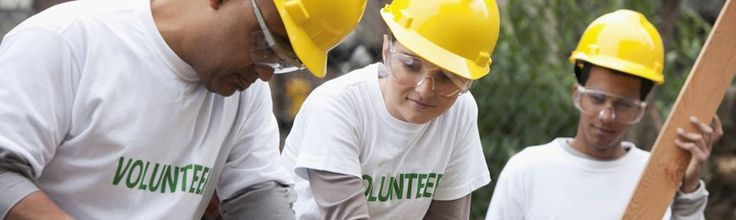 Student volunteers helping at a residential construction site