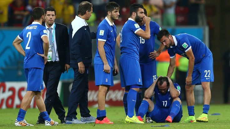 Theofanis Gekas of Greece is consoled by Andreas Samaris after missing his penalty kick