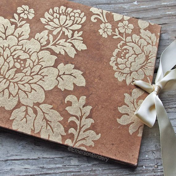 Country Wedding Guest Book, Gold and Brown Tea Stained Floral, Select a size, MADE upon ORDER. French country inspired with an aged, vintage look. The ivory luminescent floral design shimmers with a pearlized gold iridescence. I've enhanced the covers with spray dye giving a tea stained, time worn, attic treasure feel. Ties closed with an ivory satin ribbon. Available on Etsy.