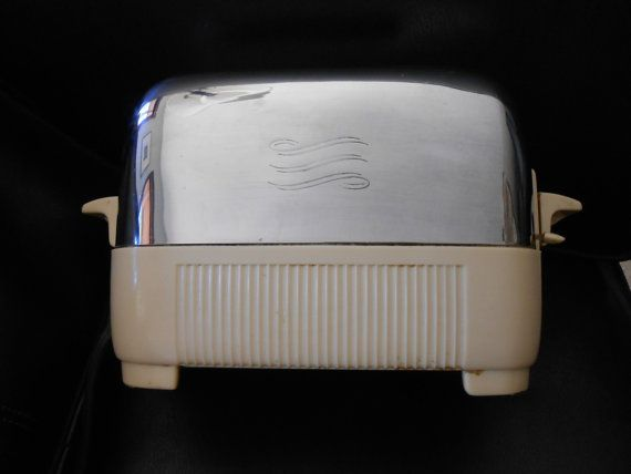 Mid-century GE Bakelite Catalin...our exact toaster when I was little, but with brown catalin. Toaster Works by ReplayItAgainSam