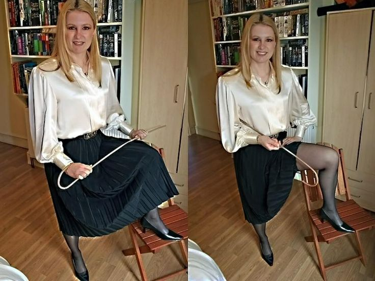 Sexy mistress in a satin blouse