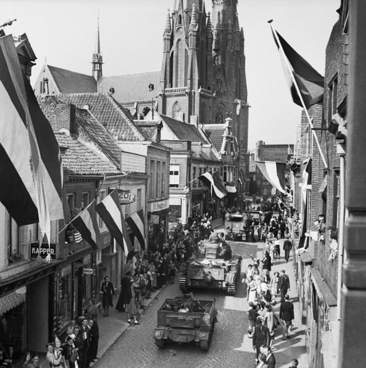 Cheering crowds line the streets greeting the Cromwell tanks of 2nd Welsh Guards entering Eindhoven/19 September 1944. Pin by Paolo Marzioli