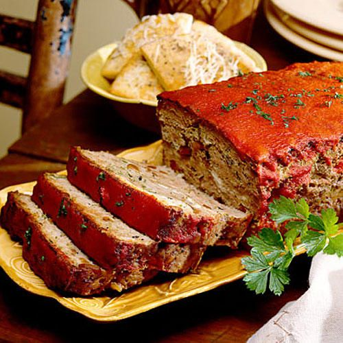 Lamb Meatloaf with Feta Cheese - Must-Try Meatloaf Recipes - Southernliving. Recipe: Lamb Meatloaf with Feta Cheese This meatloaf is incredibly rich and savory. Rather than use the traditional ground beef, this meatloaf is made with lean ground lamb, and spiced with fresh garlic. Crumbly feta cheese then gets sandwiched between the lamb layers. This meatloaf also boasts the savory flavors of toasted pine nuts, dried basil, rosemary, and fresh parsley. Because it is lamb, it will take a…