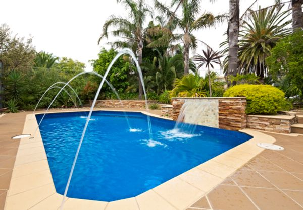Bermuda pool design with deck jets and waterfall at the for Pool jets design