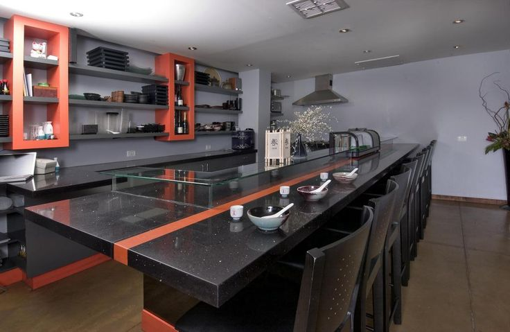 http://www.drissimm.com/wp-content/uploads/2014/12/exotic-black-marble-kitchen-countertop-design-with-black-orange-scheme-interior-plus-bar-stools-idea-and-gray-painting-wall-including-shelves-on-the-wall-above-backsplash.jpg