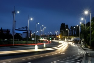 Wrexham at night. Travel this road into the heart of the town.