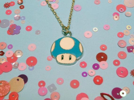 Blue Mario Mushroom Necklace by candycarouseljewels on Etsy, £4.00