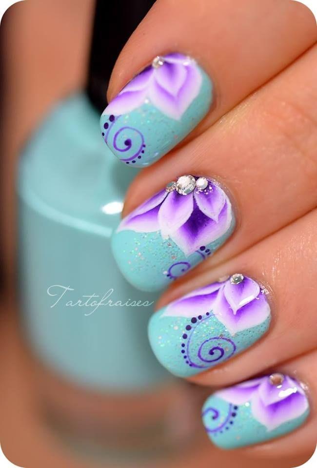 Very pretty powder blue and purple flower nails