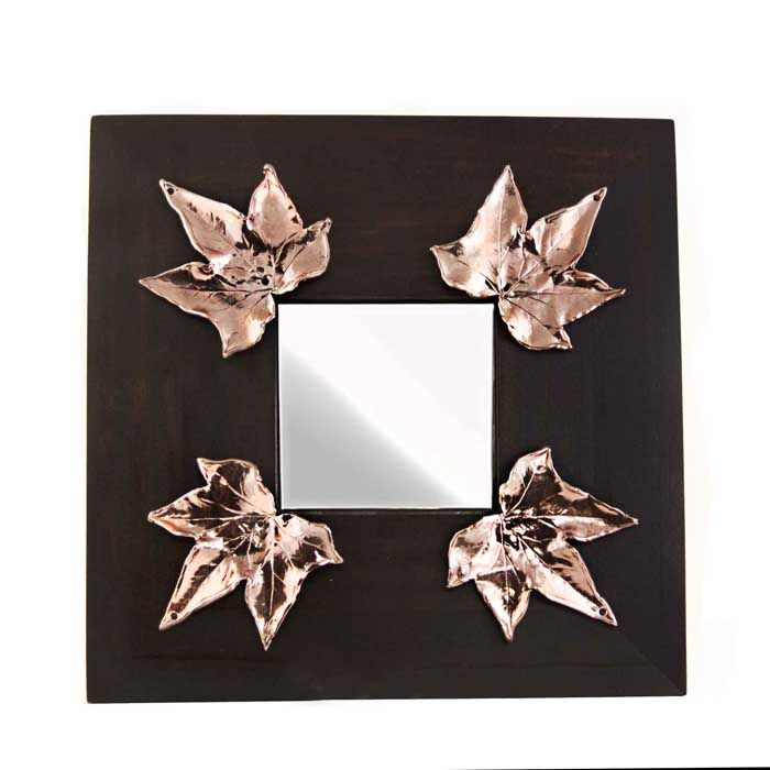 Wooden mirror with four ivy leaves. The drawing and engraving on wax by the artist Marios Voutsinas. Dimensions: 25 cm x 25 cm x 1 cm  Copper.