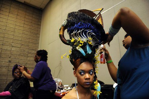 Atlanta Hair Show 2013 | From left, Twyla Mays, 20, gets an oversized head piece shaped like a ...