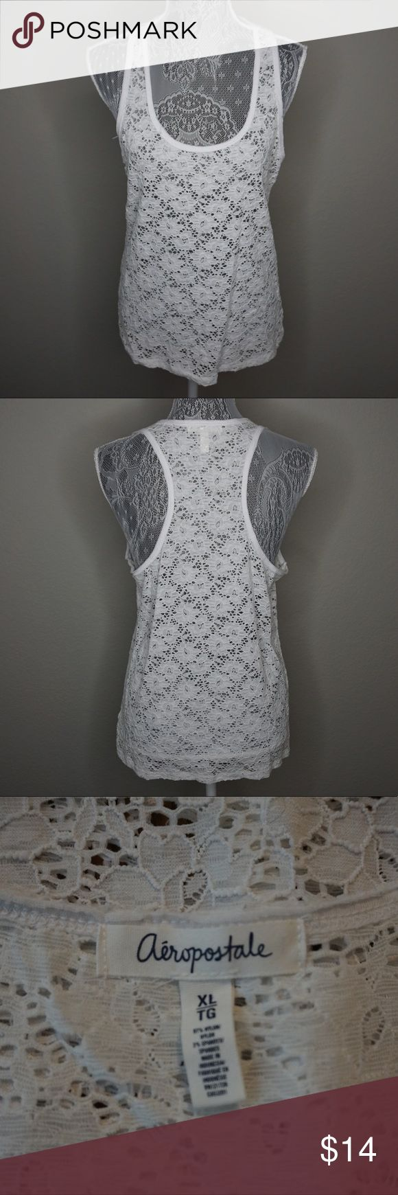 White Lace Racerback Tank Perfect for layering, this tank doesn't have much stretch to it. Would be adorable over a night swimming suit or paired with linen or denim capris, or even a colorful maxi skirt. Aeropostale Tops Tank Tops