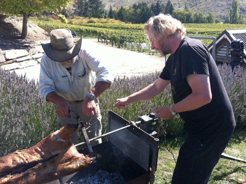 Felton Road's Nigel Greening and Danny prepare to remove the picking team's dinner from the spit...smell that crackling!