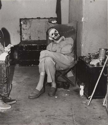 """Weegee (Arthur Fellig), """"Dressing room behind the circus ring, Ringling Brothers and Barnum & Bailey Circus"""", 1944.   Gelatin silver print, printed circa 1950."""