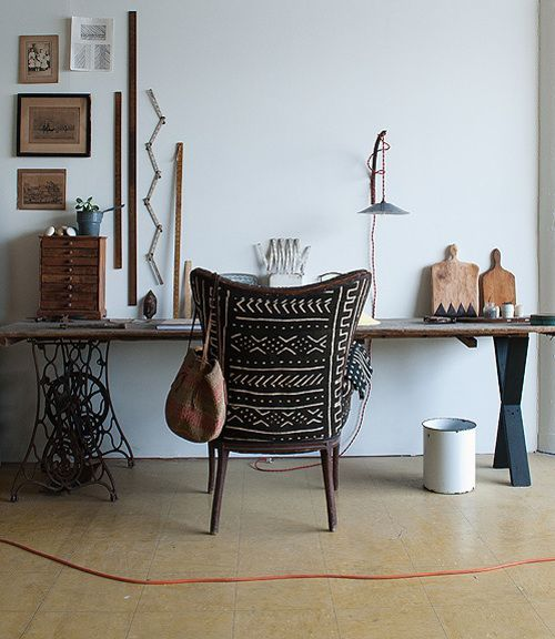A vintage chair upholstered in mud cloth from the Brooklyn studio of woodworker Ariele Alasko.