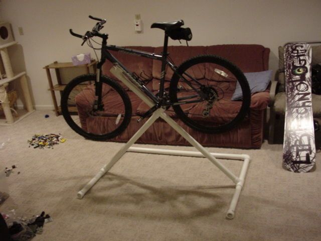 PVC Bike Repair Stand.  http://www.instructables.com/id/PVC-Bike-Repair-Stand/