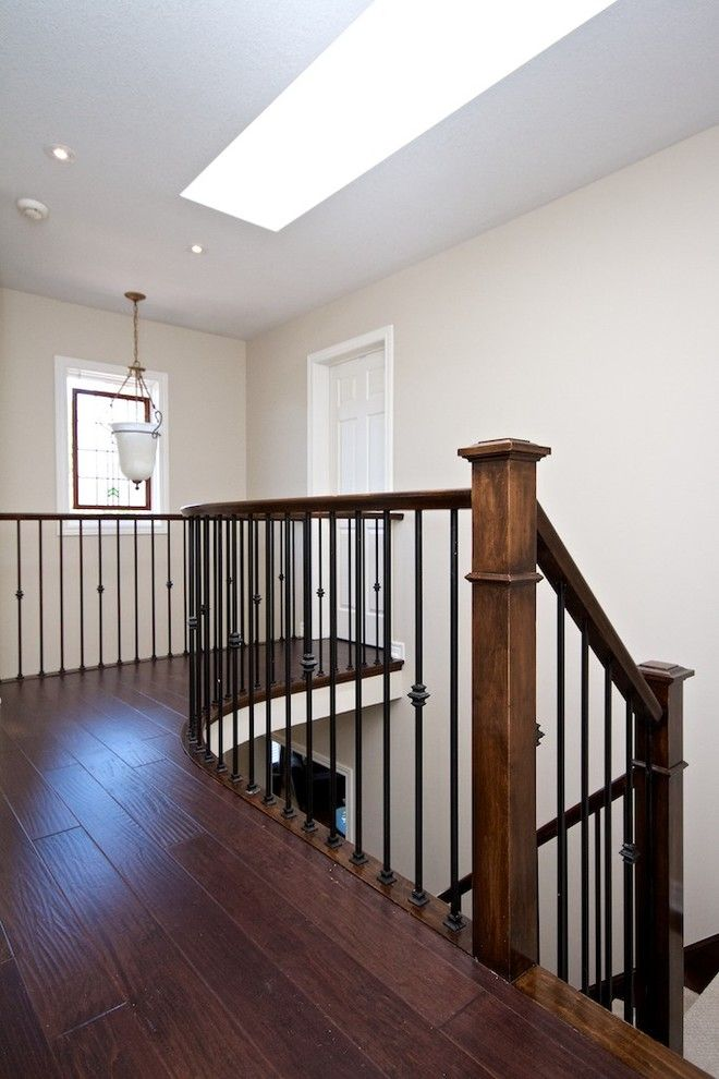 rod iron spindles Staircase Contemporary with hardwood floor oak newal