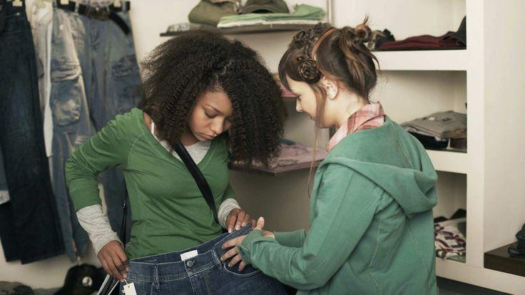 Teen girls shopping for blue jeans