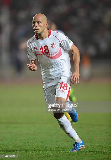 Yassin Mikeri of Tunisia in action during the FIFA 2014 World Cup qualifier at the Stade Olympique de Radès on October 13 2013 in Rades Tunisia
